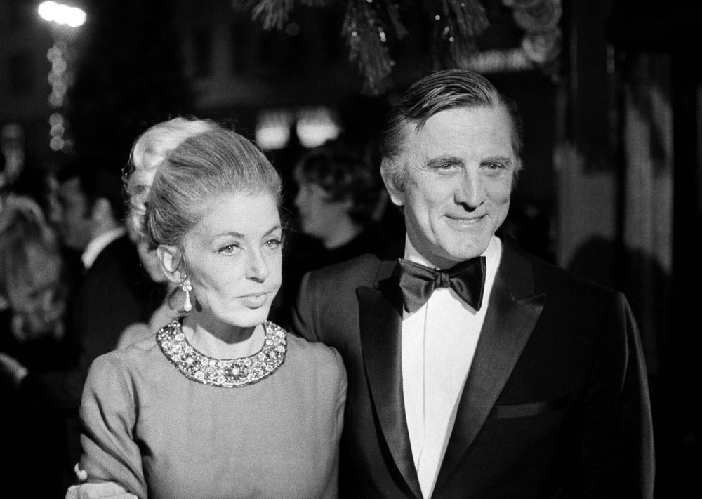 FILE - This Dec. 19, 1969 file photo shows actor Kirk Douglas and his wife, Anne, attending the premiere of