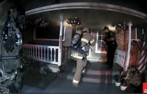 Firefighters prepare to rescue a wheelchair-bound woman from a burning home  in Idaho Falls