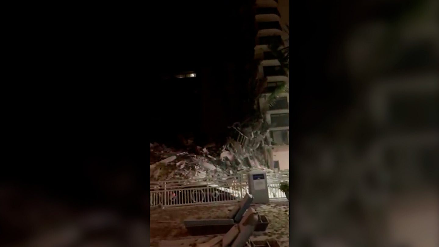 <i>Adriana Sarmiento/ Roberto Castillero</i><br/>Video taken by a couple staying at a nearby hotel shows debris and gushing water in the underground parking garage of the Surfside condominium building minutes before it collapsed.