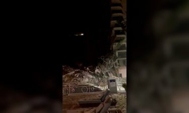 Video taken by a couple staying at a nearby hotel shows debris and gushing water in the underground parking garage of the Surfside condominium building minutes before it collapsed.
