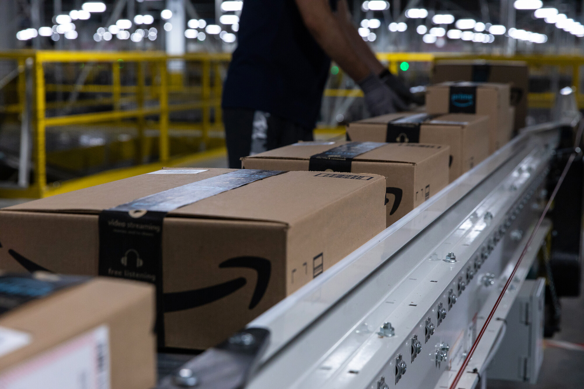<i>Rachel Jessen/Bloomberg/Getty Images</i><br/>Boxes move along a conveyor belt at an Amazon fulfillment center on Prime Day in Raleigh