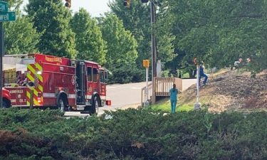 Emergency crews are on scene near the Planned Parenthood in Asheville after barrels with 'HAZMAT' labels were discovered outside Saturday morning.