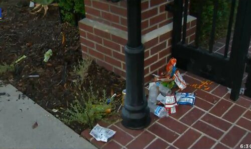 Trash sits outside the gate of Los Angeles Mayor Eric Garcetti's home. Protestors angered over an odinance restricting homeless encampments vandalized the property on July 29.