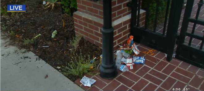 <i>KCAL KCBS</i><br/>Trash sits outside the gate of Los Angeles Mayor Eric Garcetti's home. Protestors angered over an odinance restricting homeless encampments vandalized the property on July 29.