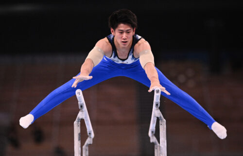 Japan's Daiki Hashimoto competes in the parallel bars event of the artistic gymnastics men's all-around final during the Tokyo 2020 Olympic Games at the Ariake Gymnastics Centre in Tokyo on July 28