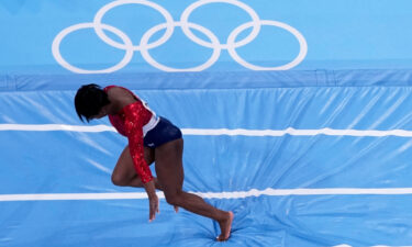 Simone Biles stumbles as she lands during the artistic gymnastics women's final at the 2020 Summer Olympics on Tuesday.