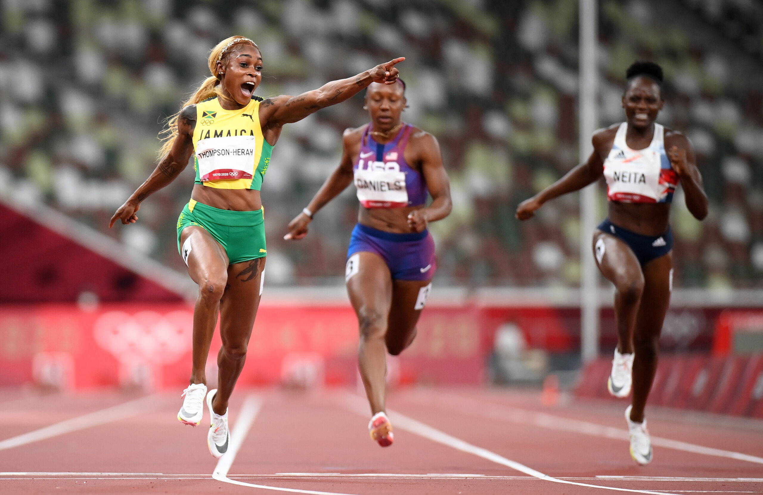 <i>Matthias Hangst/Getty Images AsiaPac/Getty Images</i><br/>Elaine Thompson-Herah celebrates as she wins 100m gold at the Tokyo Olympics.