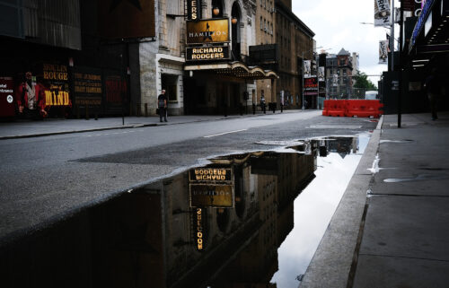 Owners and operators of all 41 Broadway theaters in New York City will require audience members and performers as well as staff to be vaccinated for all performances through the month of October. In this picture Broadway theaters are closed along an empty street in the theater district on June 30