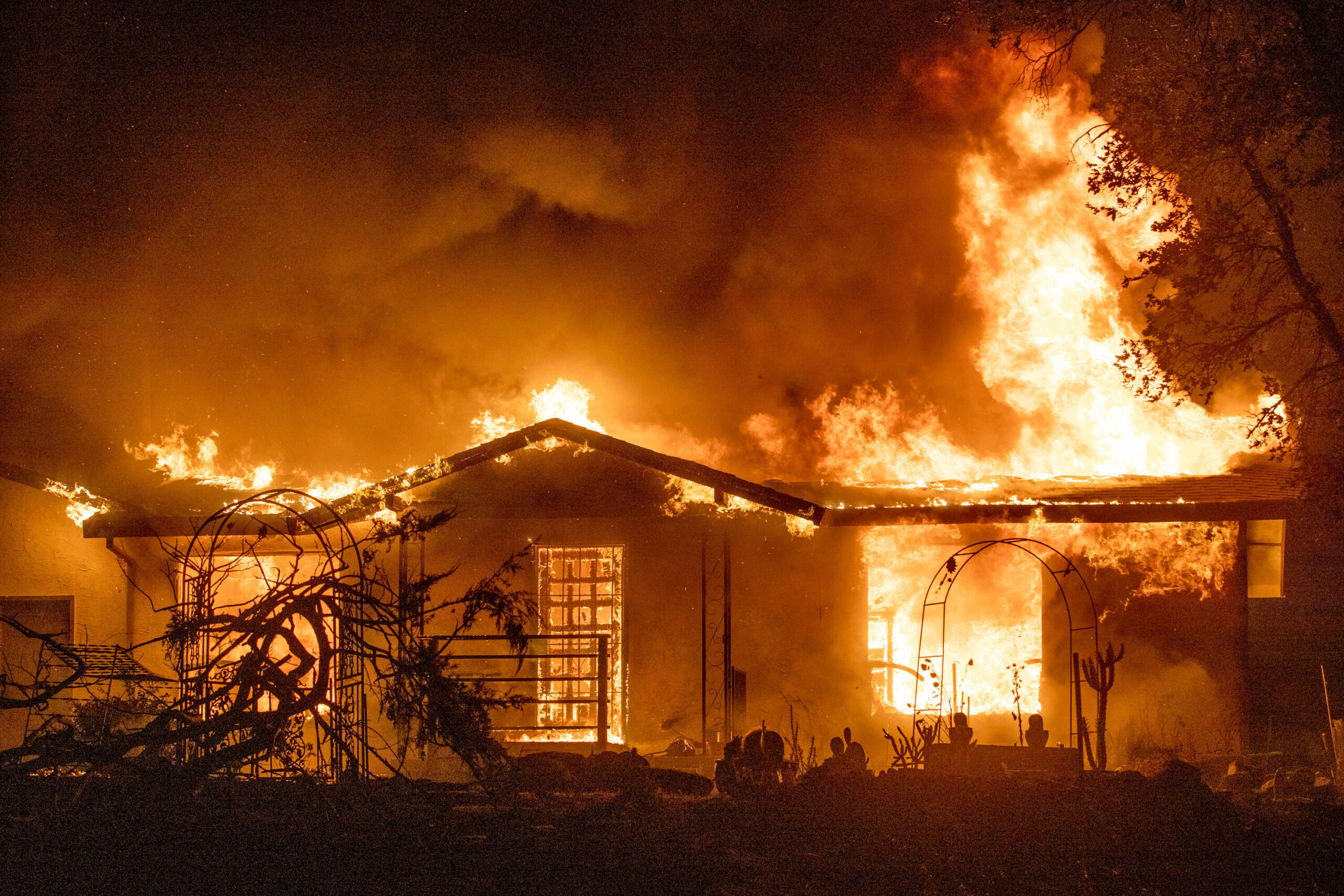<i>Ethan Swope/AP</i><br/>A house burns on Platina Road at the Zogg Fire near Ono