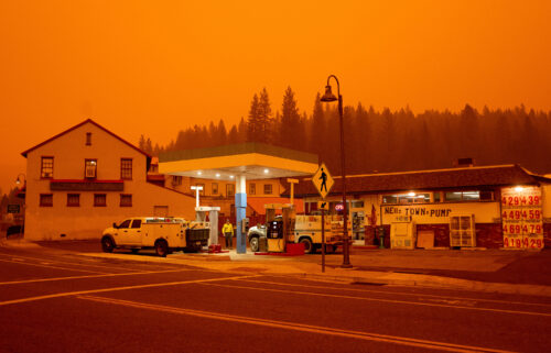 Firefighters gas up while battling the Dixie Fire in the Greenville community of Plumas County
