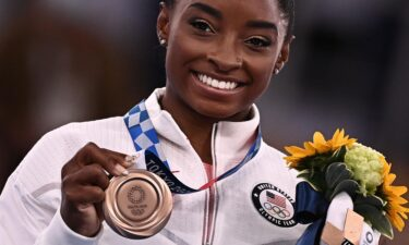 """Simone Biles will head this fall to 35 US cities for a series of exhibitions called the """"Gold Over America Tour."""" Biles won a bronze medal in the women's balance beam competition on Tuesday."""
