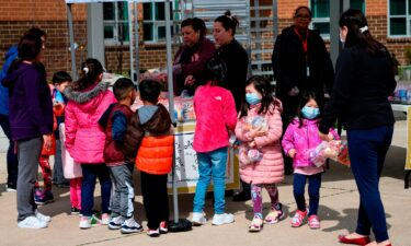 Children pick up lunch at Kenmore Middle School in Arlington