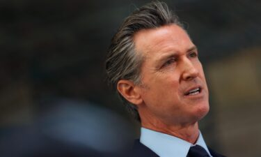 California Gov. Gavin Newsom looks on during a press conference at The Unity Council on May 10
