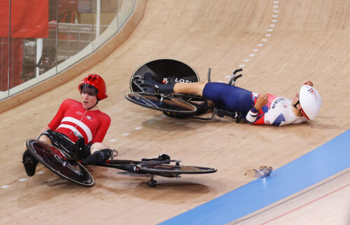 Frederik Madsen of Team Denmark and Charlie Tanfield of Team Great Britain on the ground after the fall.