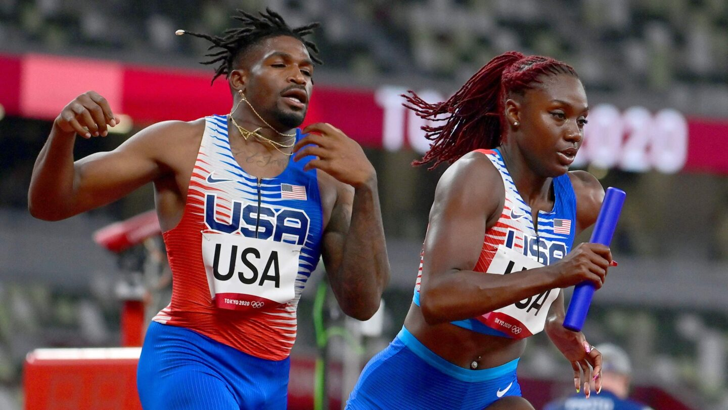 <i>JAVIER SORIANO/AFP/Getty Images</i><br/>USA's Elija Godwin and Lynna Irby compete in the mixed 4x400m relay heats during the Tokyo 2020 Olympic Games on July 30.