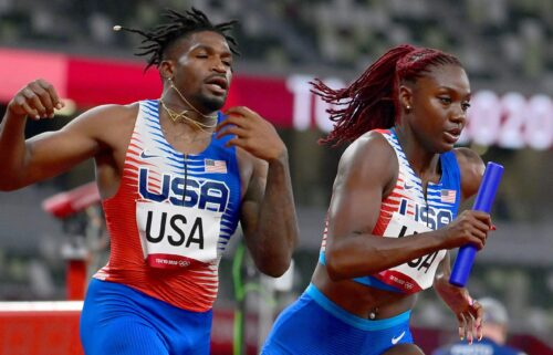 USA's Elija Godwin and Lynna Irby compete in the mixed 4x400m relay heats during the Tokyo 2020 Olympic Games on July 30.