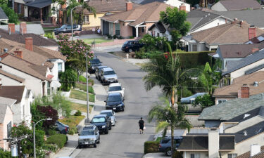 The US household debt soared to nearly $15 trillion last quarter. This image shows a Los Angeles neighborhood on July 30.