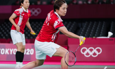 Chen Qingchen and Jia Yifan of China compete during the badminton women's doubles gold medal match in the Tokyo 2020 Olympic Games.