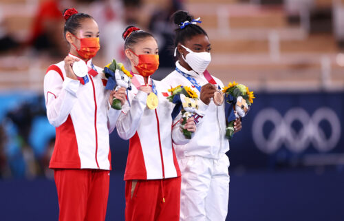 China's Guan Chenchen won gold in the women's balance beam final at the Tokyo Olympics as Simone Biles claimed a bronze.
