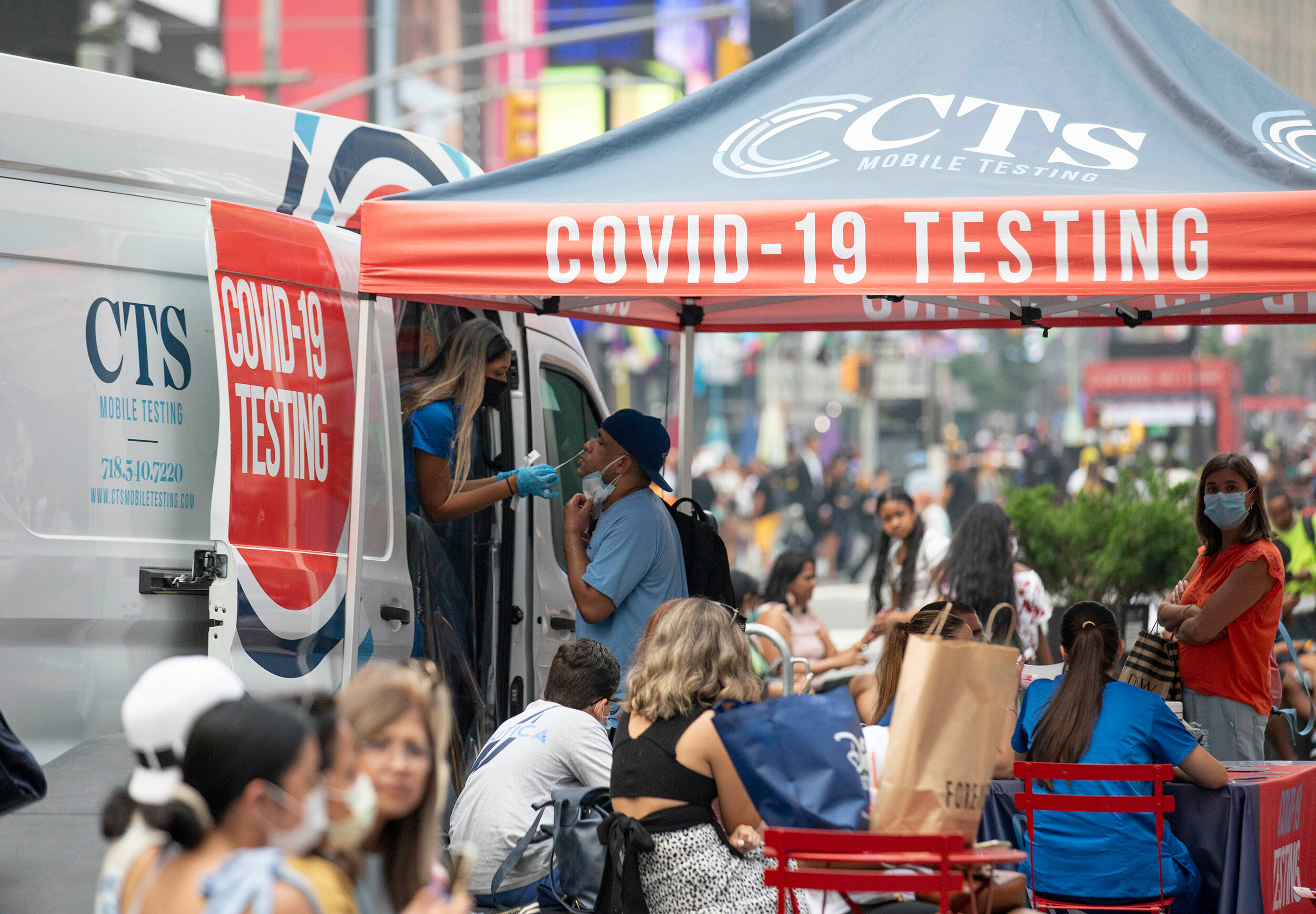 <i>Wang Ying/Xinhua/Sipa USA/FILE</i><br/>A man receives a Covid-19 test at a mobile testing site in Times Square