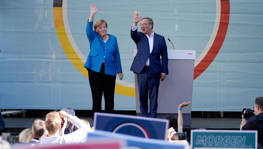 <i>Martin Meissner/AP</i><br/>Chancellor Angela Merkel and Armin Laschet