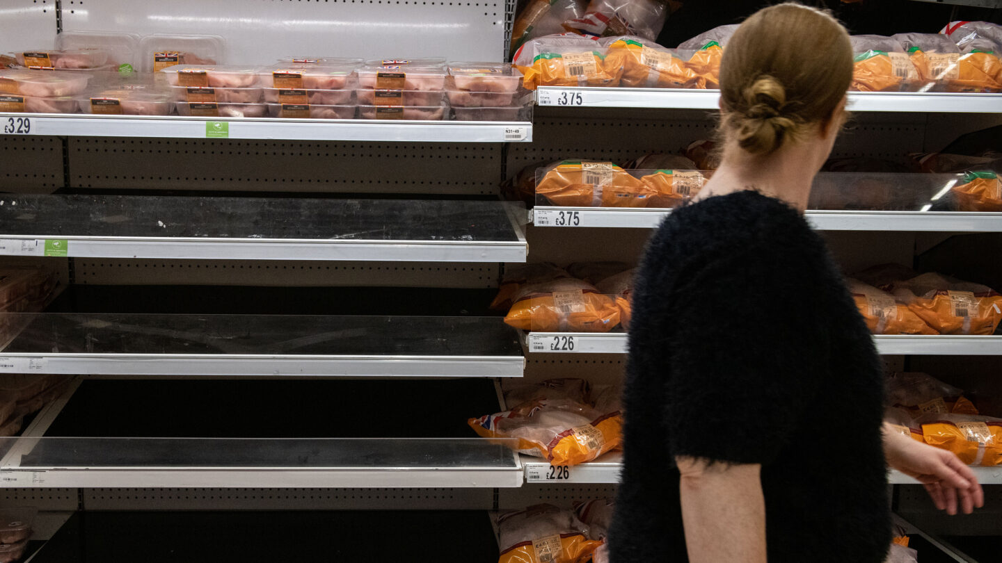<i>Chris J Ratcliffe/Getty Images</i><br/>Shelves usually stocked with chicken stand empty at an Asda supermarket on September 19 in London.