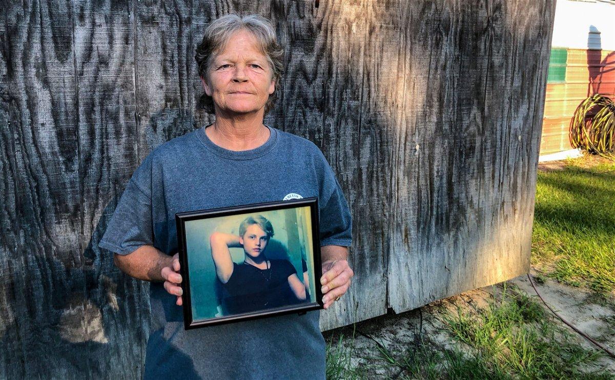 <i>Kacen Bayless/AP</i><br/>Sandy Smith holds a photo of her late son