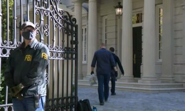 FBI agents are shown here at the Washington home of Russian oligarch Oleg Deripaska.