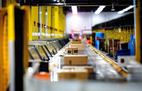 Packages move along a conveyor at Amazon fulfillment center in Eastvale on Tuesday