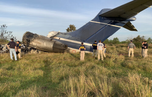 A McDonnell Douglas MD-87 airplane carrying 21 people rolled through a fence and caught fire on take-off at the Houston Executive Airport on October 19. Authorities say no-one was seriously hurt as passengers on the plane report being told to 'Get out